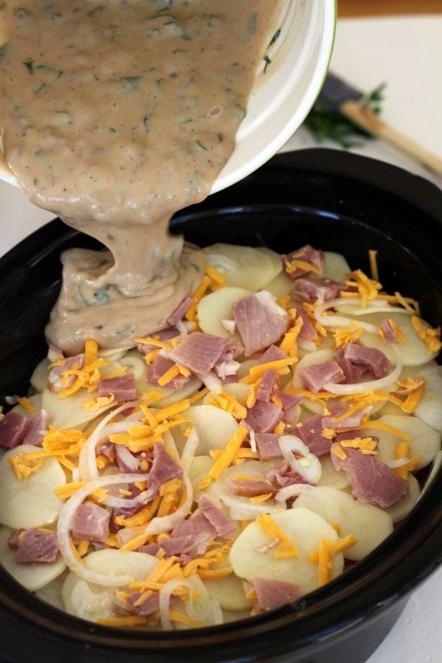 milk mixture over potatoes