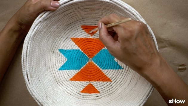Creating faux woven effect on DIY desert-style baskets.
