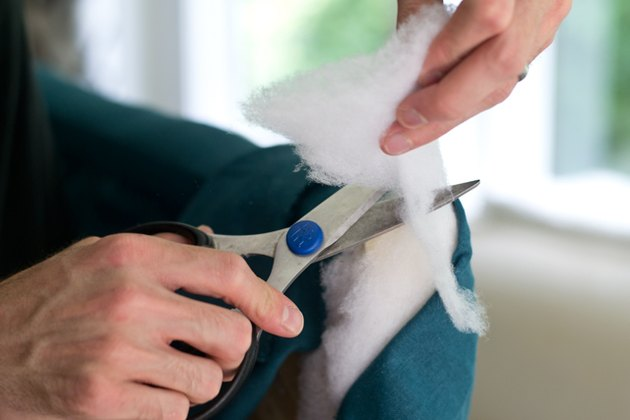 Remove excess batting with scissors.