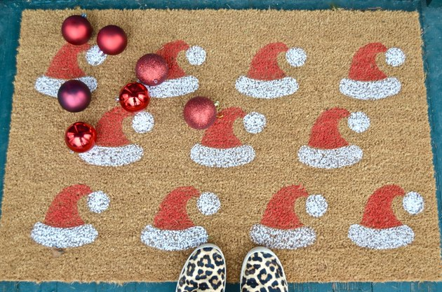 DIY red and white stenciled santa hat welcome mat