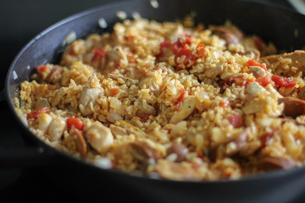 Cooked paella mixture in a pan