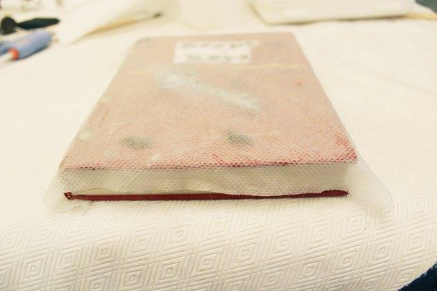 Wet paper towel over book.