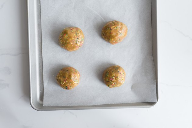 Place the evenly sized cookie dough balls onto the baking trays.