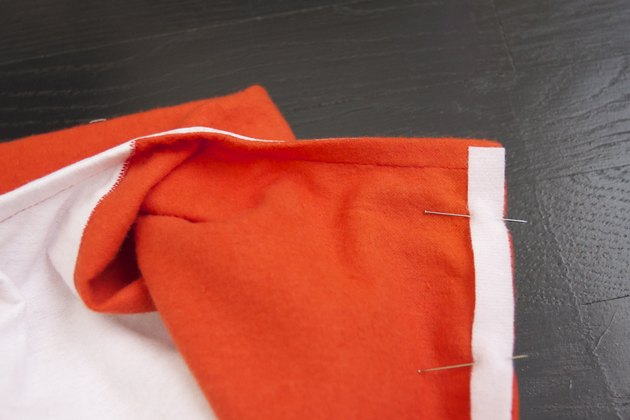 On the right side of the costume, pin the loop strip in place.