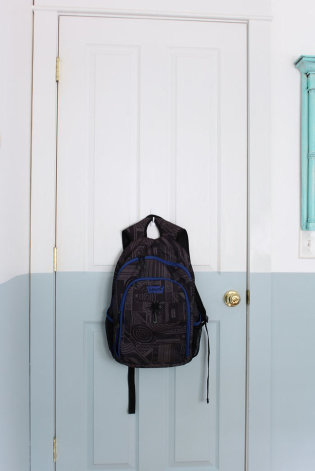 A hook on the back of the door adds storage space.