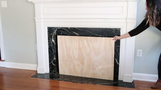 Checking plywood matches size of fireplace opening
