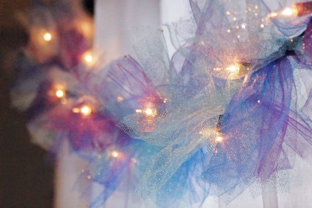 Tie strips of mesh ribbon around a strand of string lights to create a whimsical lighted garland.