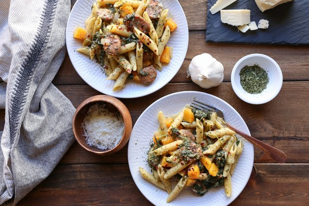 Two plates of butternut squash and sausage pasta