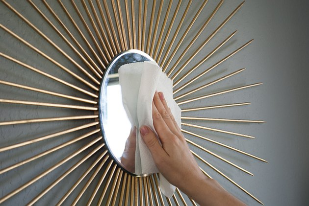 Hang the mirror and clean any smudges