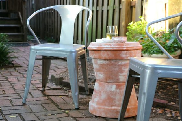 Outdoor accent table made out of terra cotta pots.