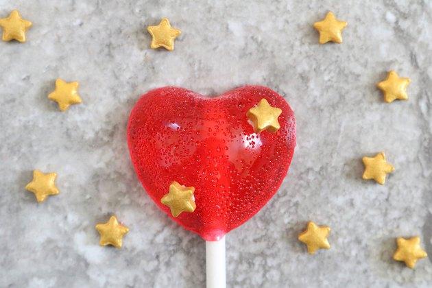 Emoji heart lollipop