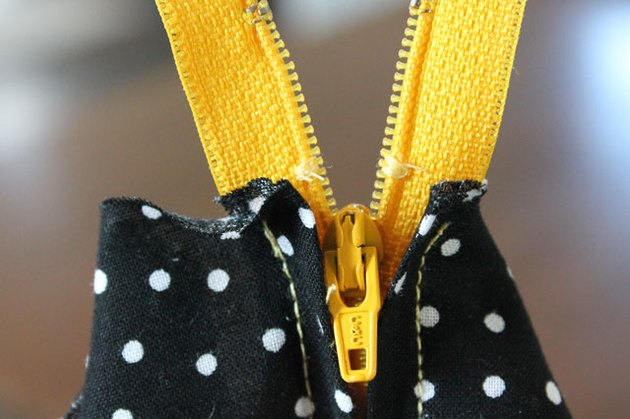 Stitch across both sides of the zipper teeth.