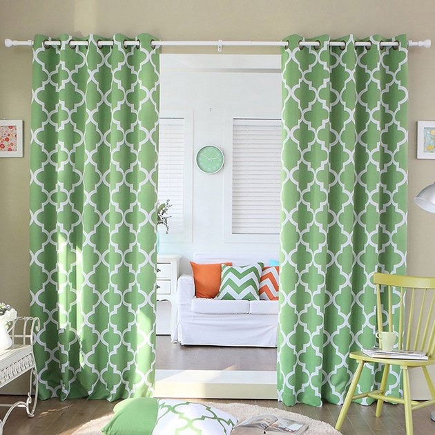 green patterned drapery panels