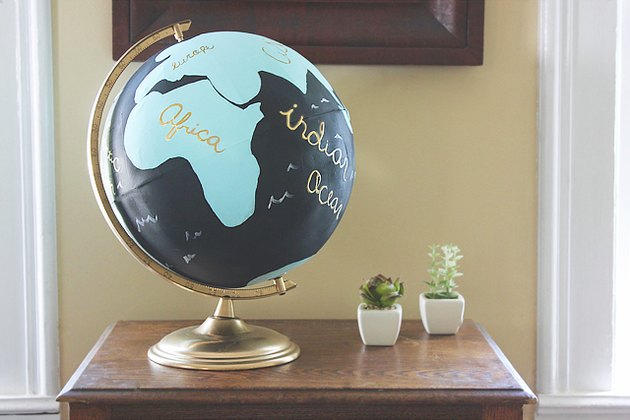 painted globe on an end table