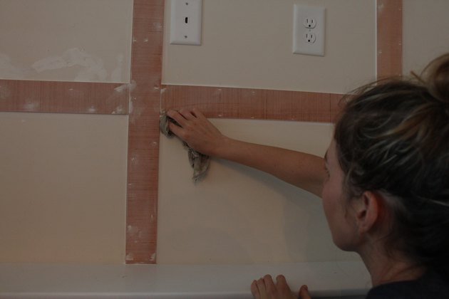 Wiping away excess caulk