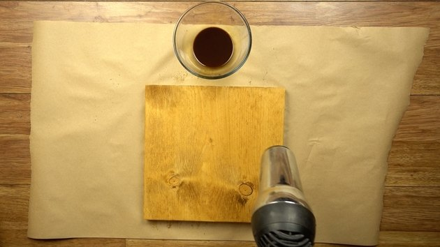 Drying instant coffee wood stain with hair dryer.