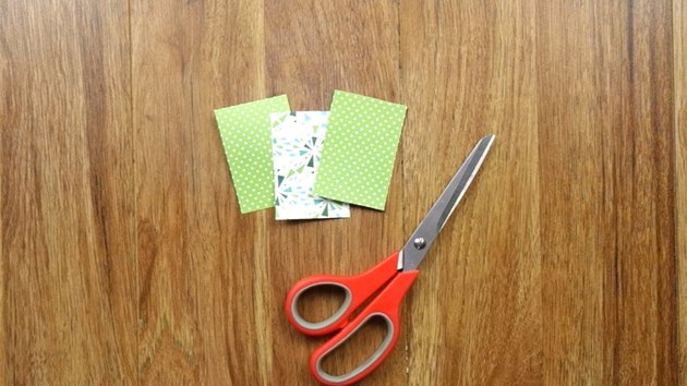 Cutting scrapbook paper to make DIY Christmas tree gift tags