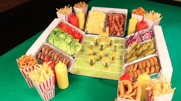 filling in the sides of the stadium with french fries, onion rings and condiment bottles