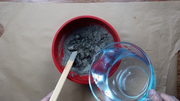 Mixing cement for DIY candles with cement base project