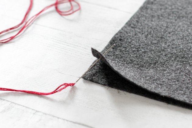 place two sides together and push needle through wrong side of felt