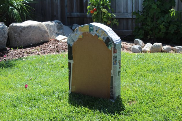 Top and sides of tombstone with paper machete.