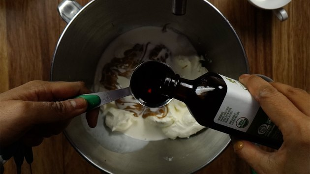 Mixing ingredients for no-bake peanut butter cream cheese pie filling.