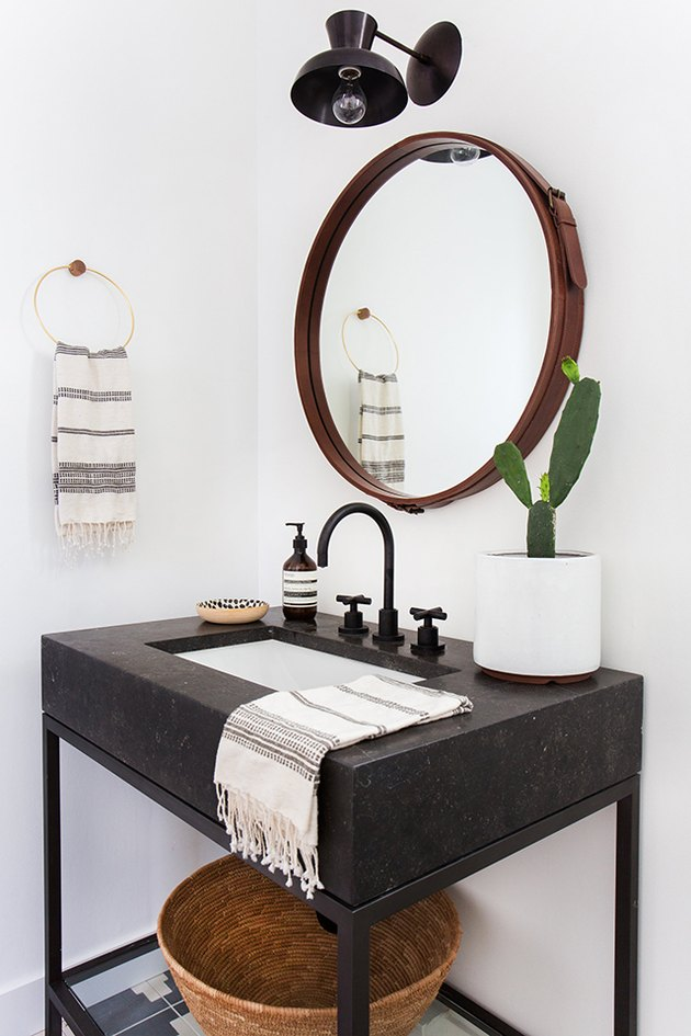 Powder room with focal mirror