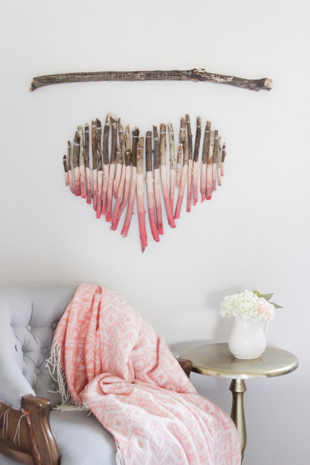 Pink ombre heart wall hanging made from branches
