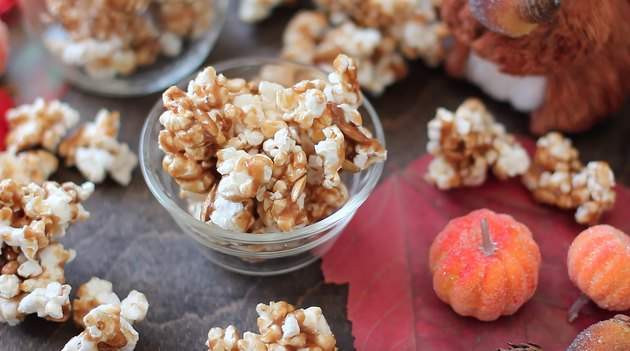 Clear bowl filled with pumpkin spice caramel corn