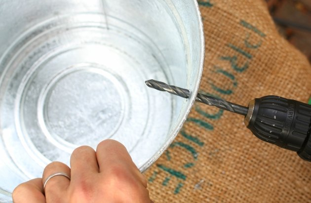 Drilling a metal pail