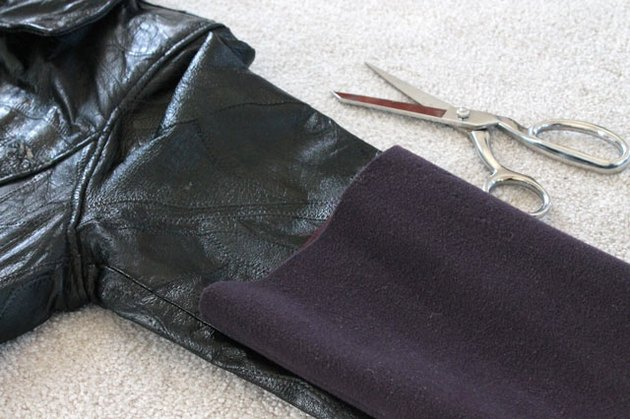 Measure, mark and cut the new sleeve from the leather coat.