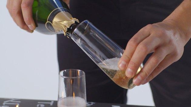 Pour champagne into flutes.