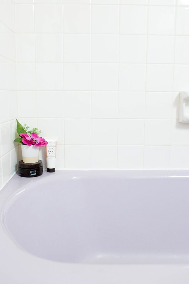 Purple bathtub with newly installed caulk
