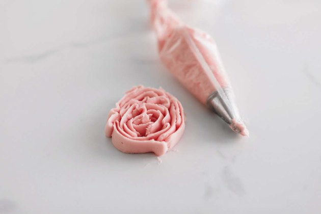 Use a petal tip to pipe a buttercream rose.