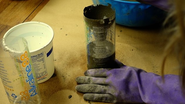 Filling plastic bottle with cement for DIY candles with cement base project