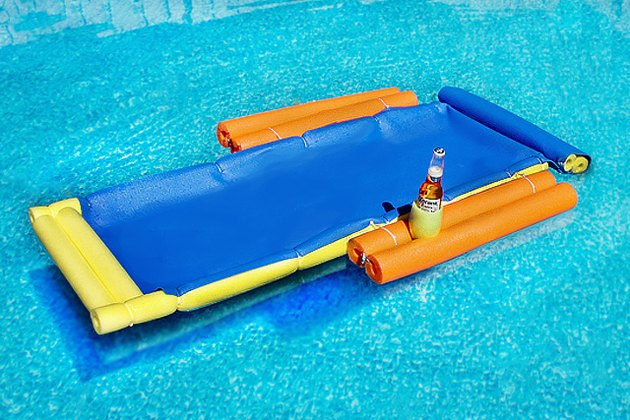 floating lounge chair in the pool with a beer in cup holder
