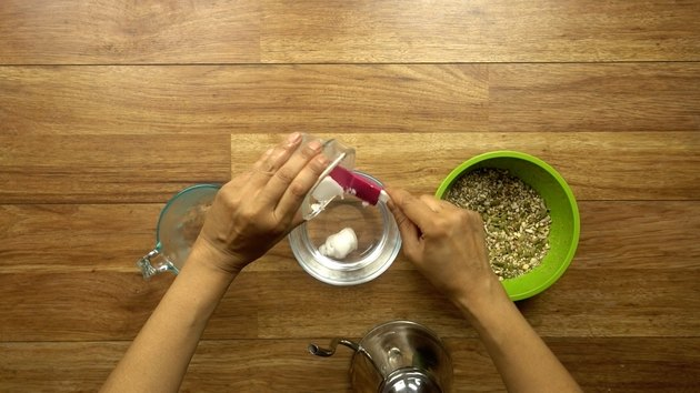 Adding coconut oil to water for healthy seed and nut crispbread crackers.