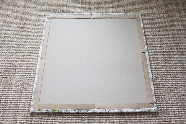 Add cardboard to the back of memo board