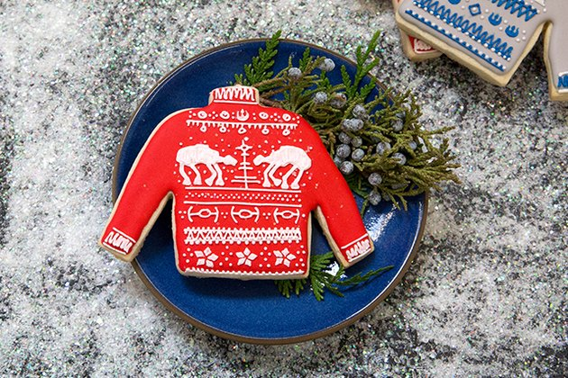Red sweater cookie with At At design