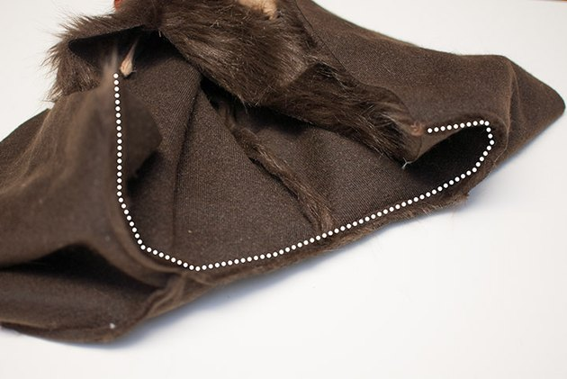 Sew the cape and hood together.
