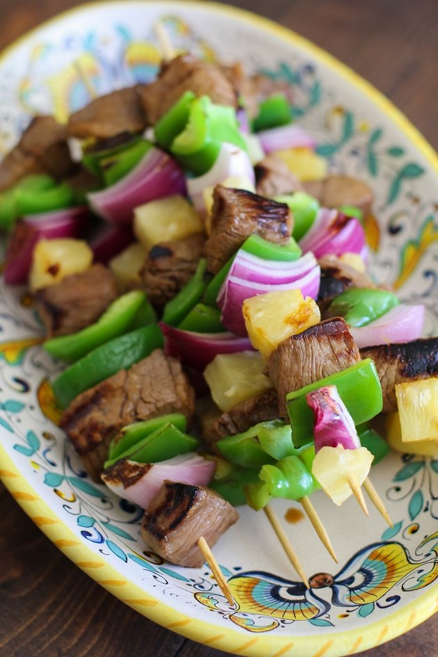 Grilled kabobs on a plate.