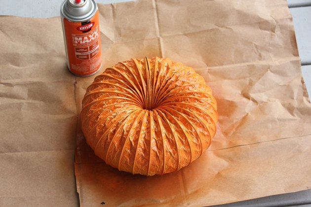 Paint the pumpkin in thin, light coats