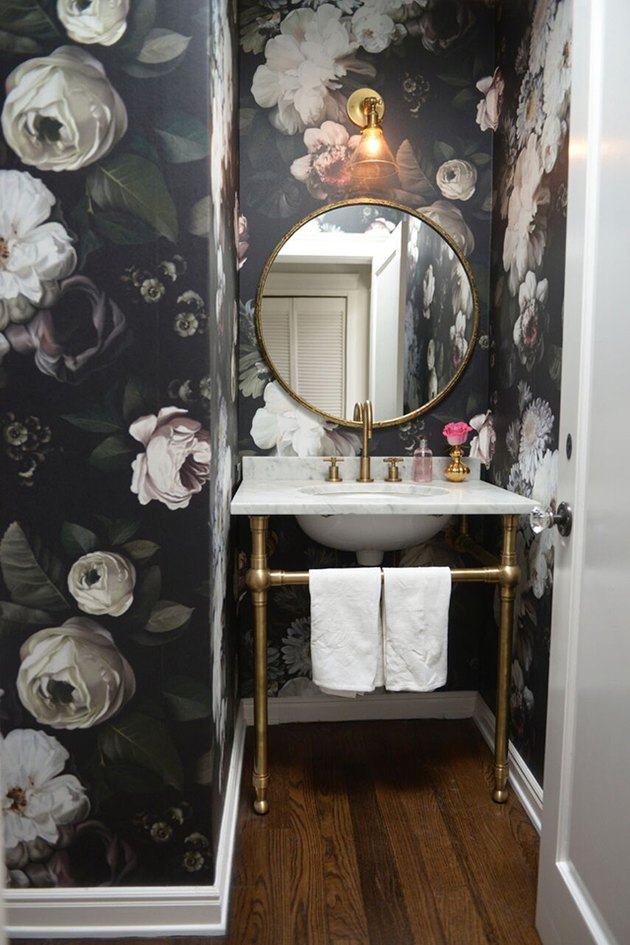 Powder room with bold floral wallpaper