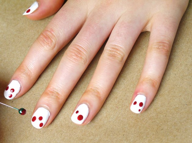 Two or Three Dots of Red Polish on Each Nail.