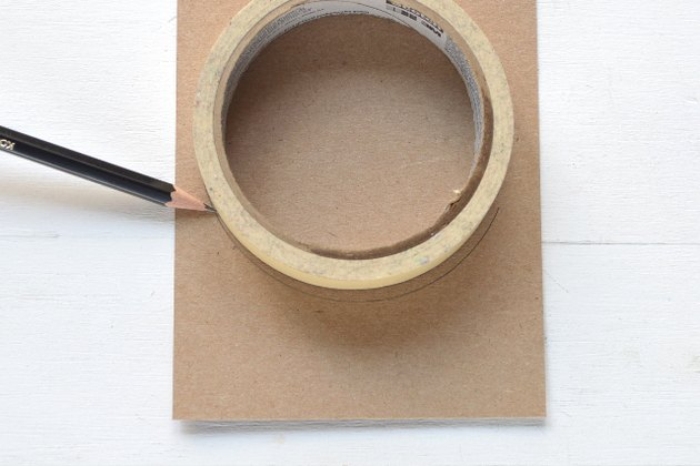 Trace the masking tape on scrap cardboard