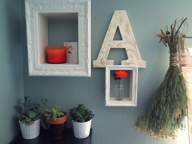Display home decor in a shadow box frame.
