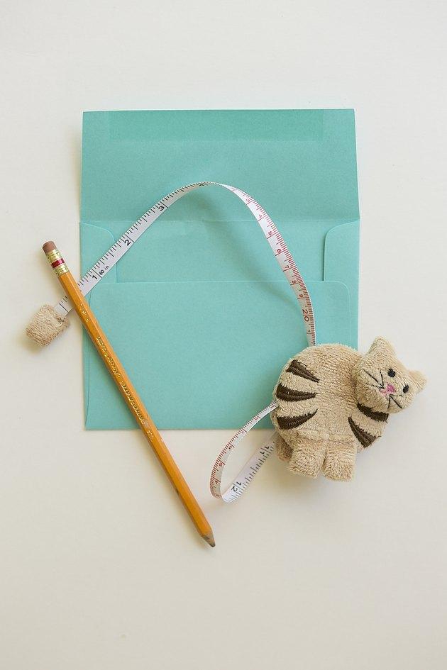 Envelope, pencil and ruler.
