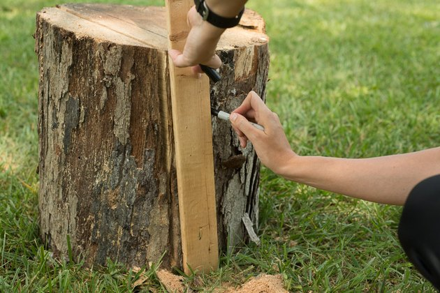 Draw a guide using a scrap piece of wood.