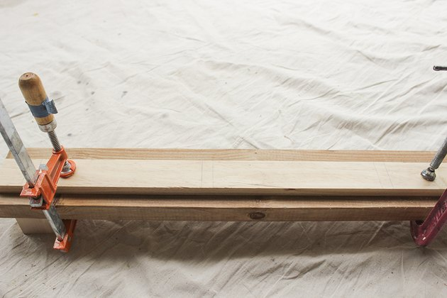 Board clamped to supportive board.