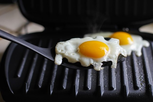 Sunny-side-up eggs on a George Foreman Grill.